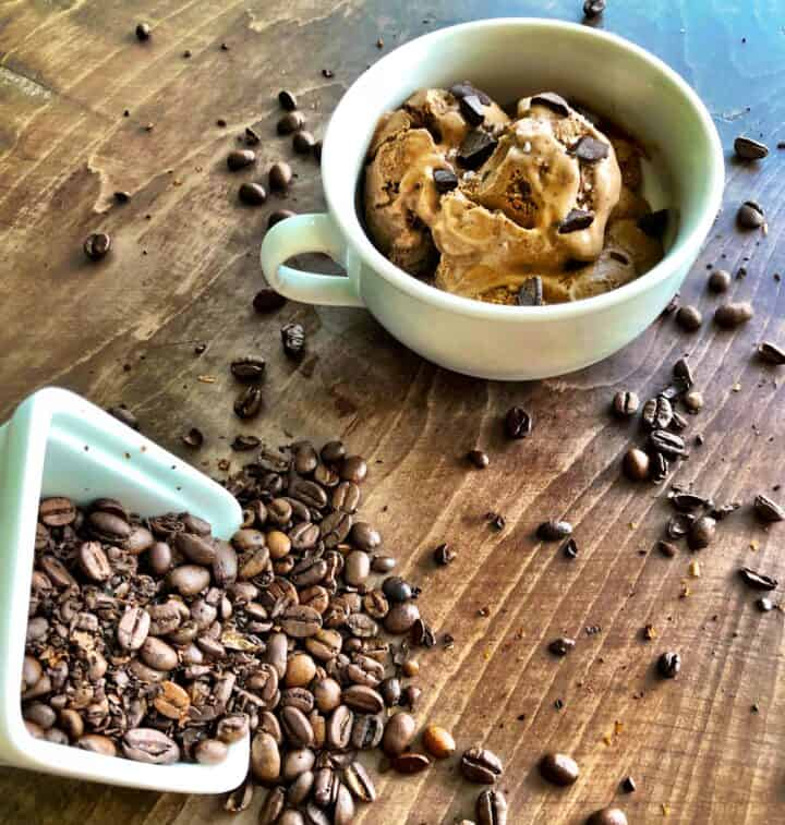 Bulletproof Coffee Ice Cream in a cup with coffee beans on a table