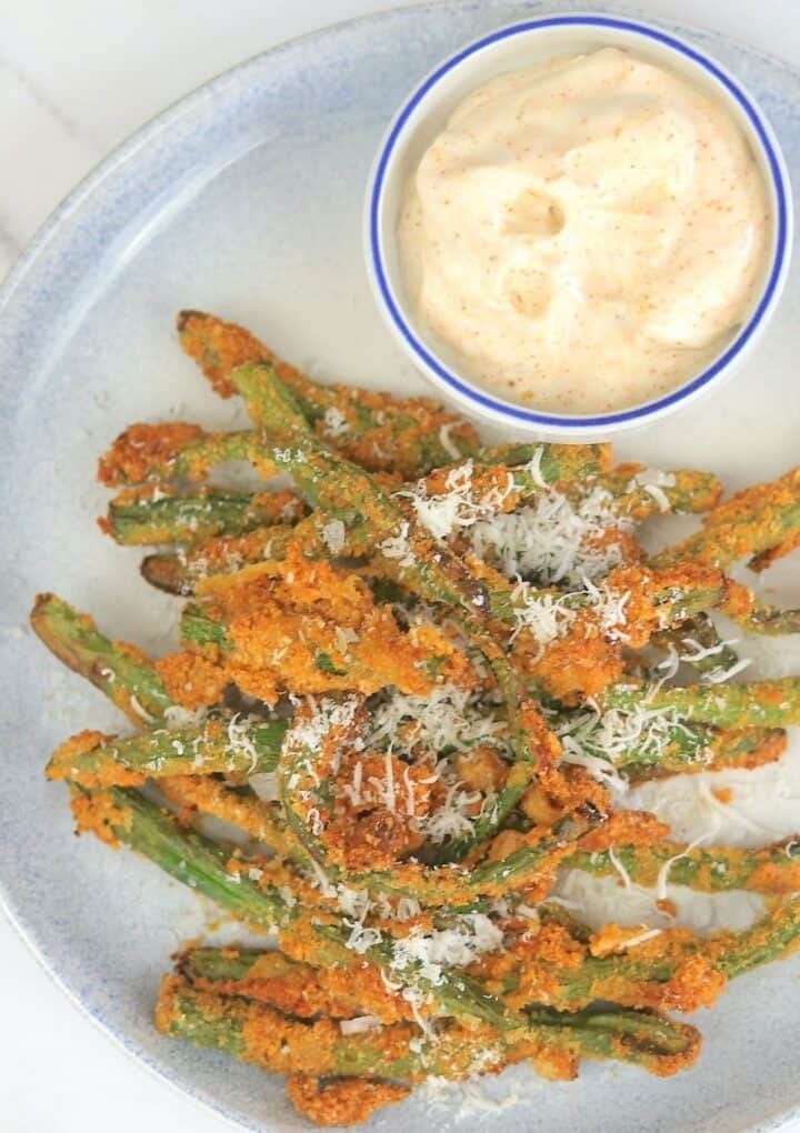 plate with air fryer green beans and dip