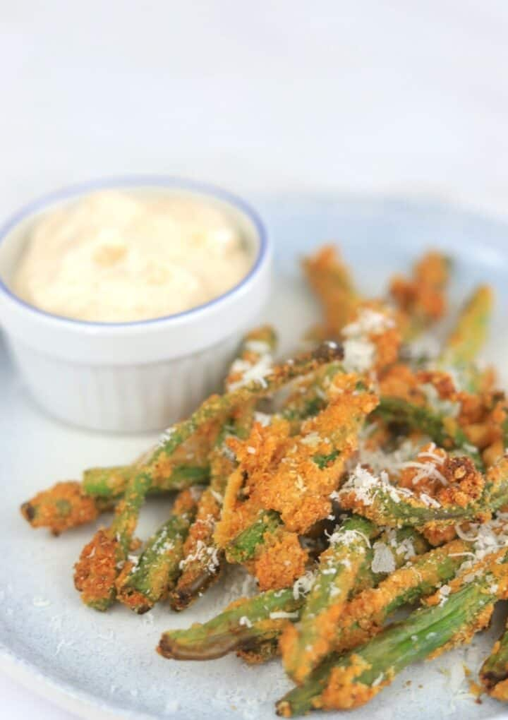 plate with green beans and dip
