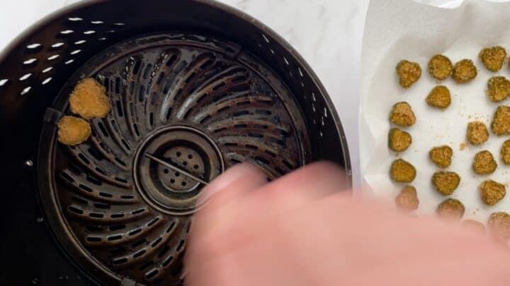 placing pickles in basket