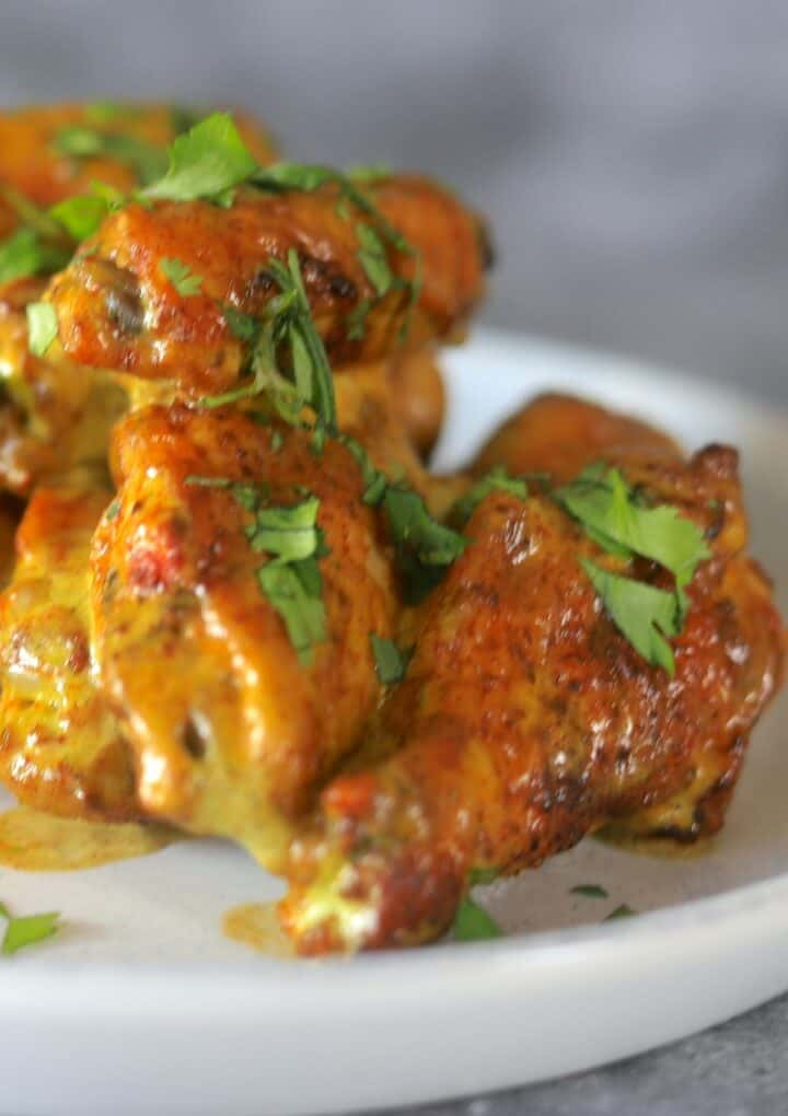 Cilantro Lime Chicken wings on a white plate