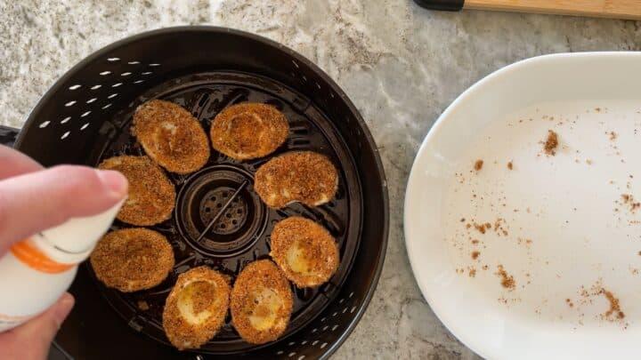 placing devilled eggs into air fryer basket