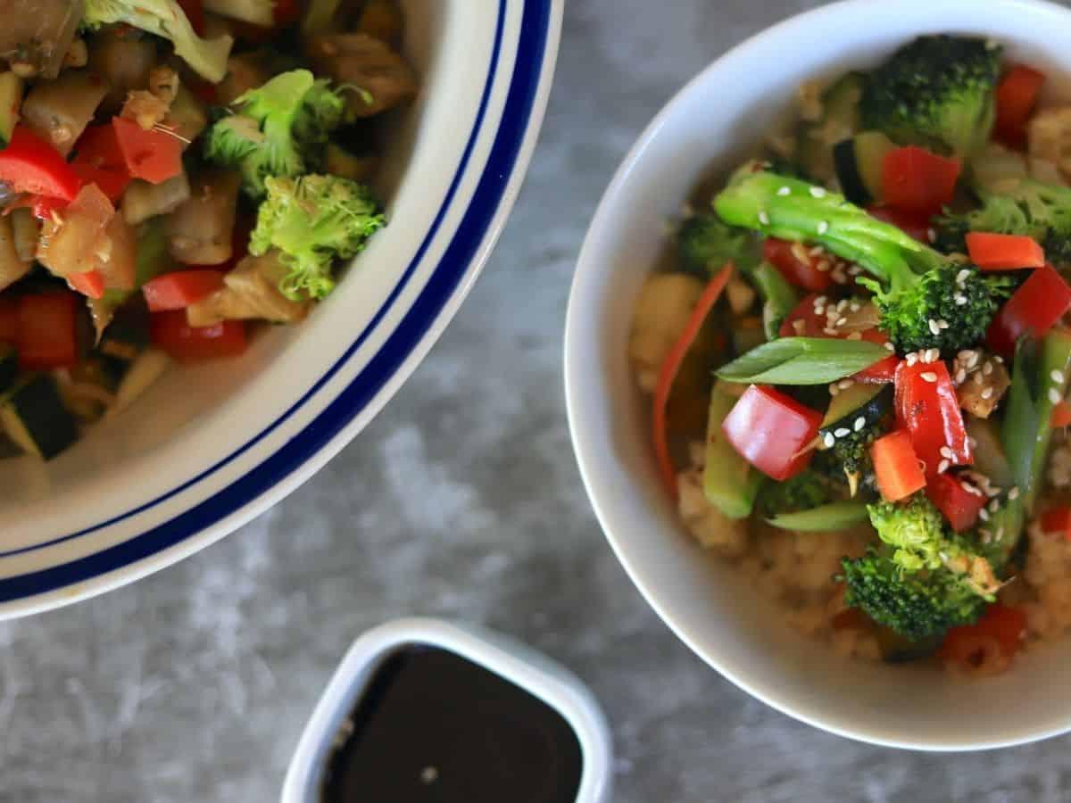vegetable stir fry on cauliflower rice in a bowl.