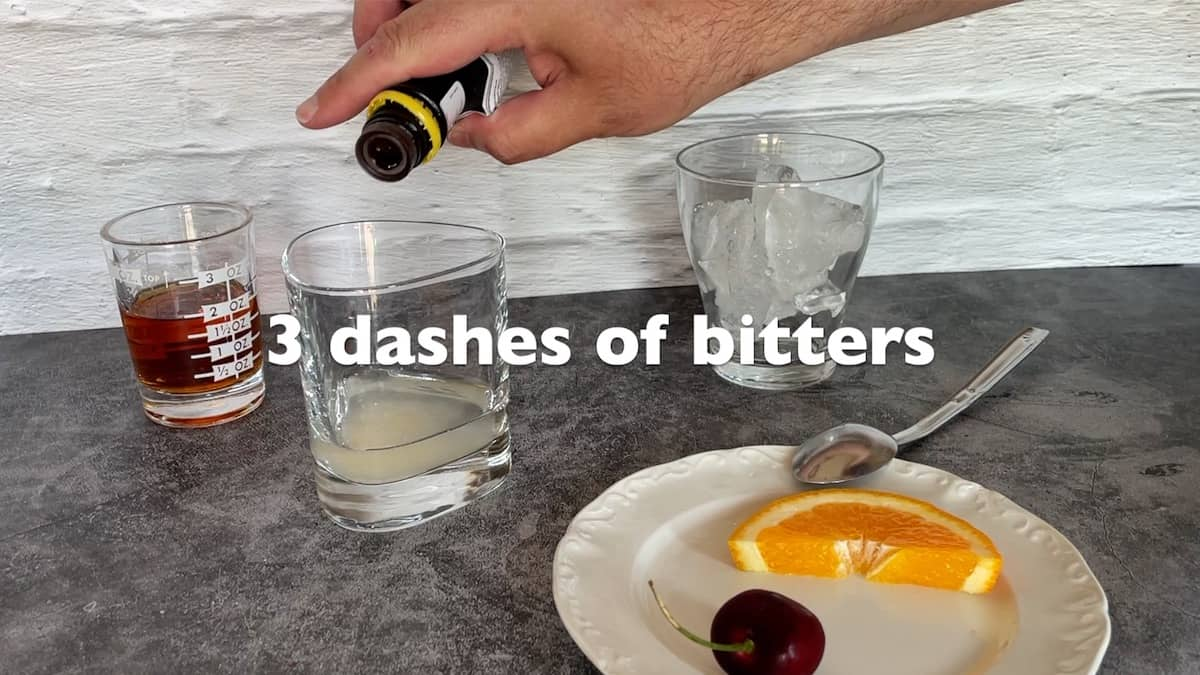adding 3 dashes of bitters