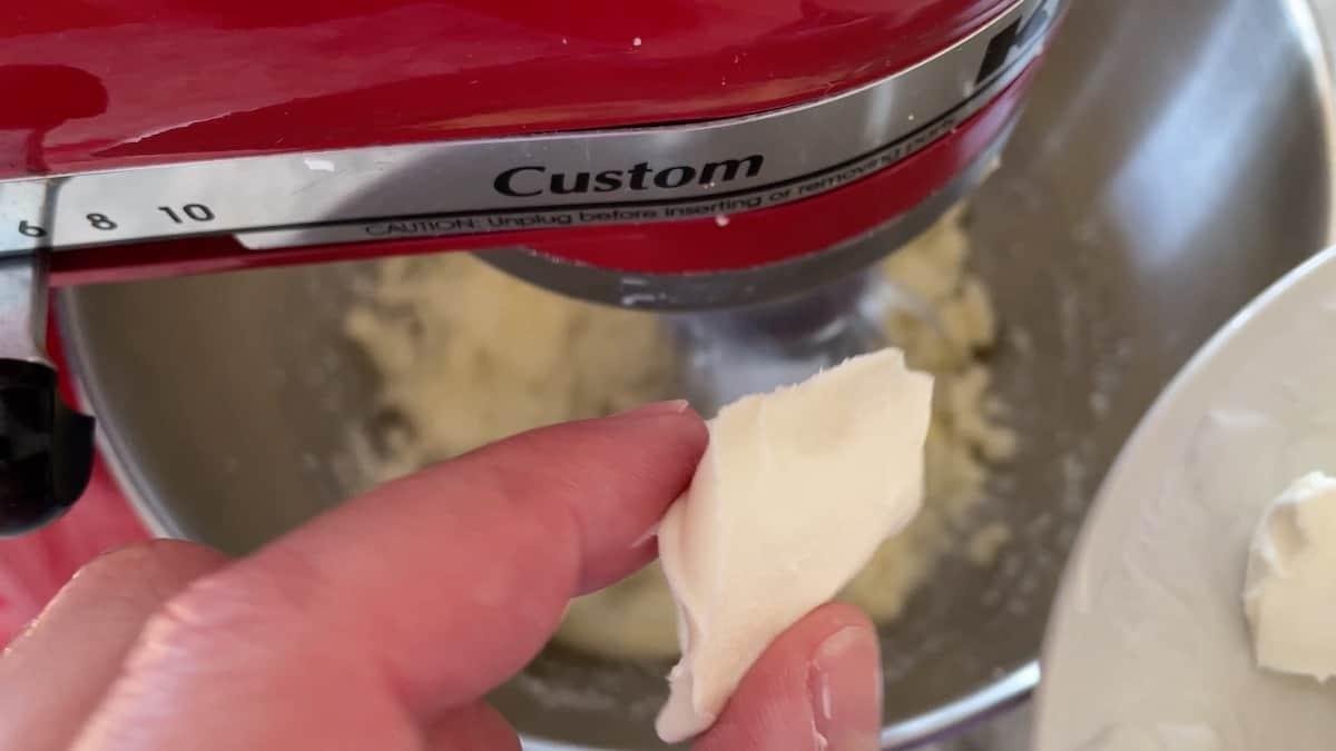 adding cream cheese to the mix