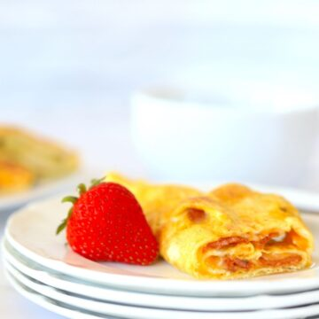 egg roll up on a plate with a strawberry