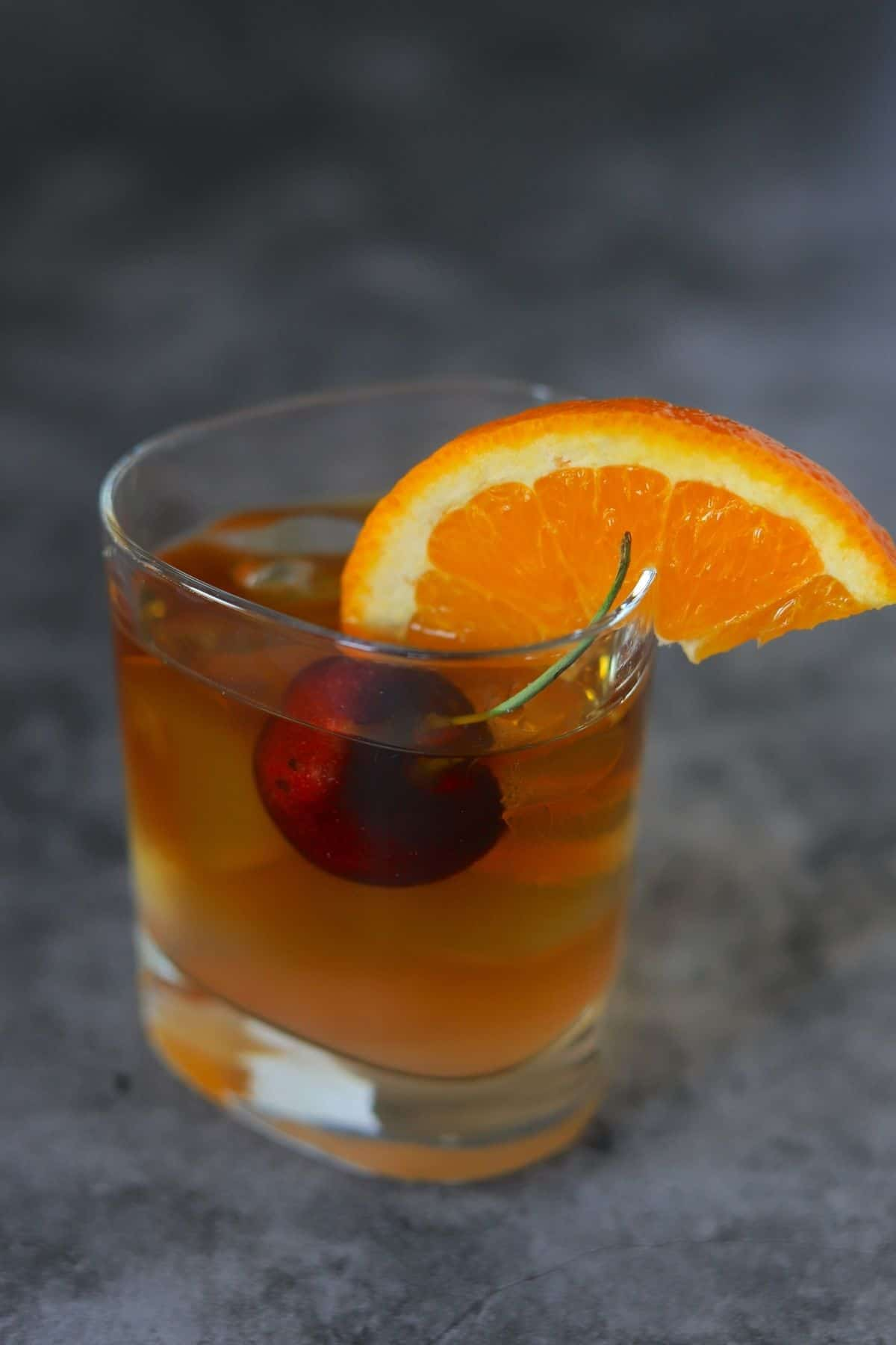 old fashioned cocktail in a tumbler
