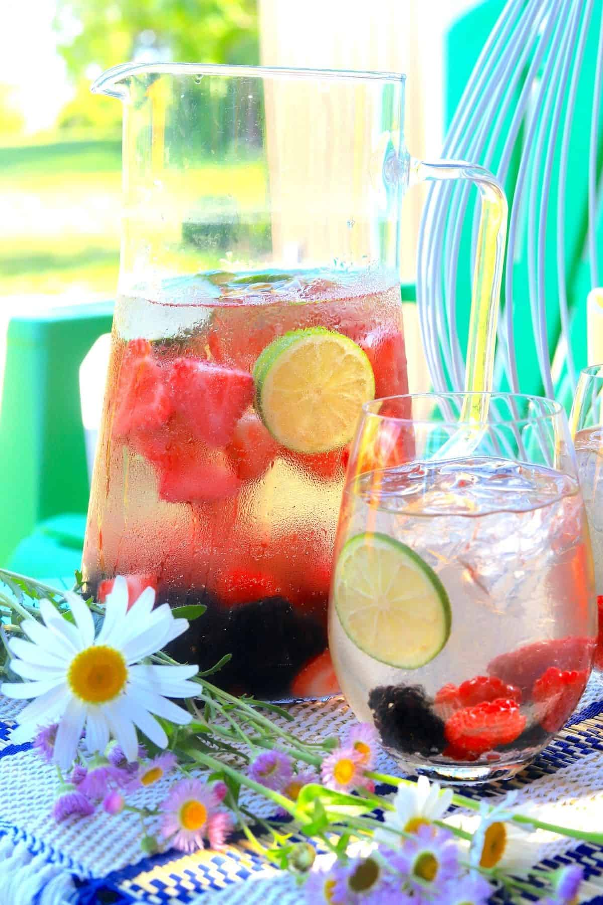 sangria in a jug and a glass with a daisy