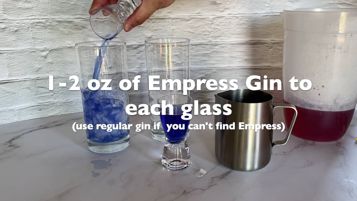 adding the gin to the cocktail glasses