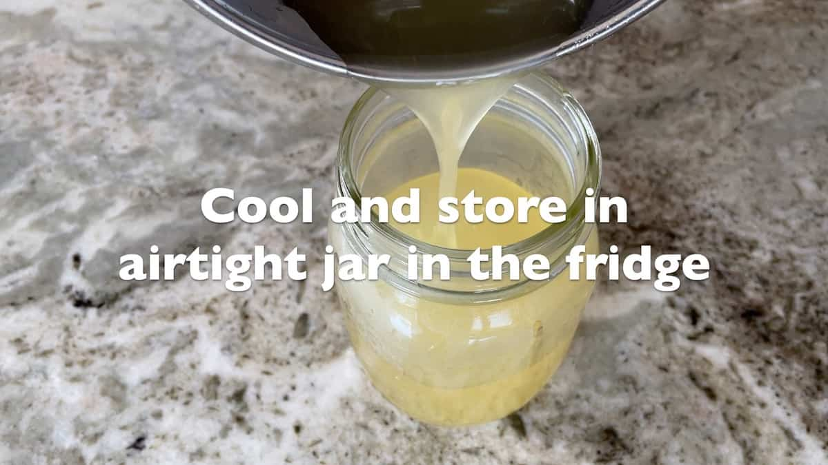 pouring simple syrup into a jar
