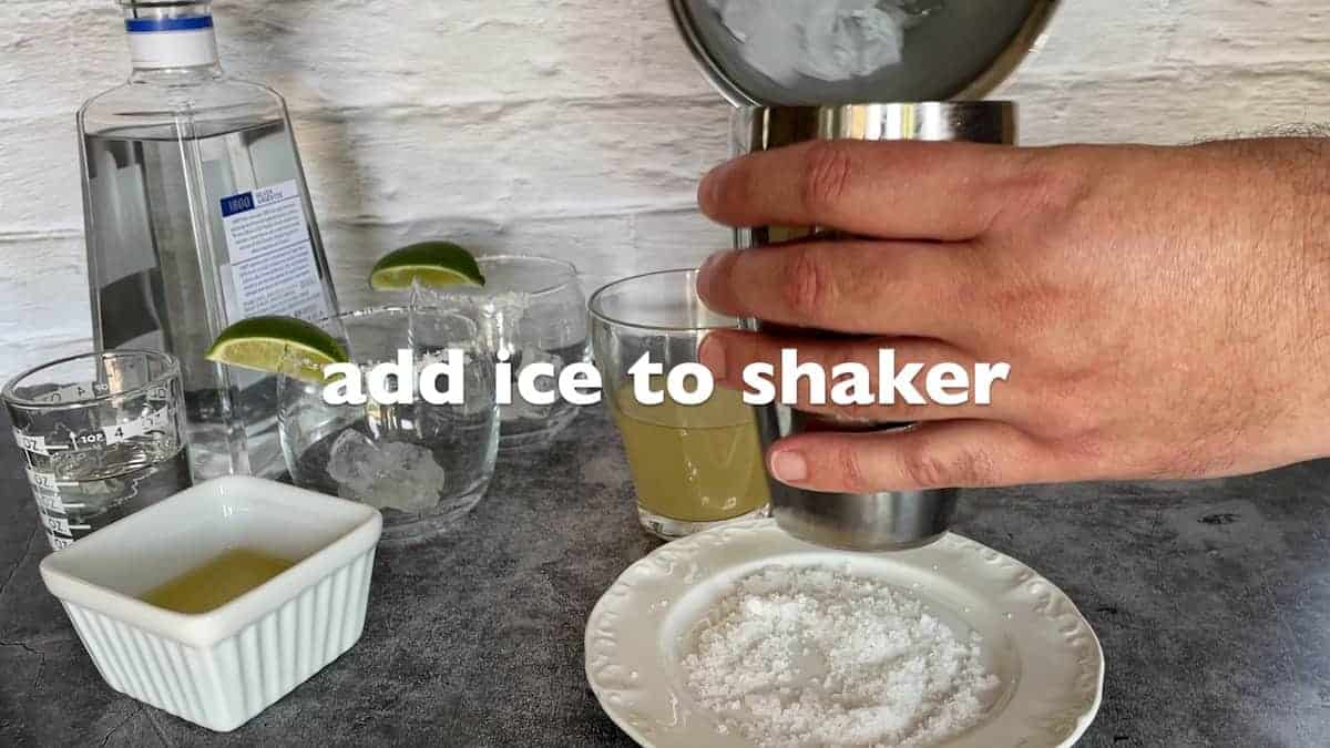 adding ice to the shaker