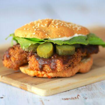 Keto Nashville hot chicken sandwich on a cutting board