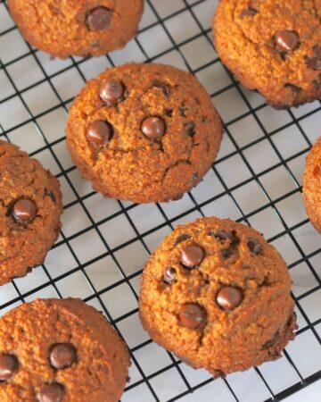 baked pumpkin cookies on a colling rack