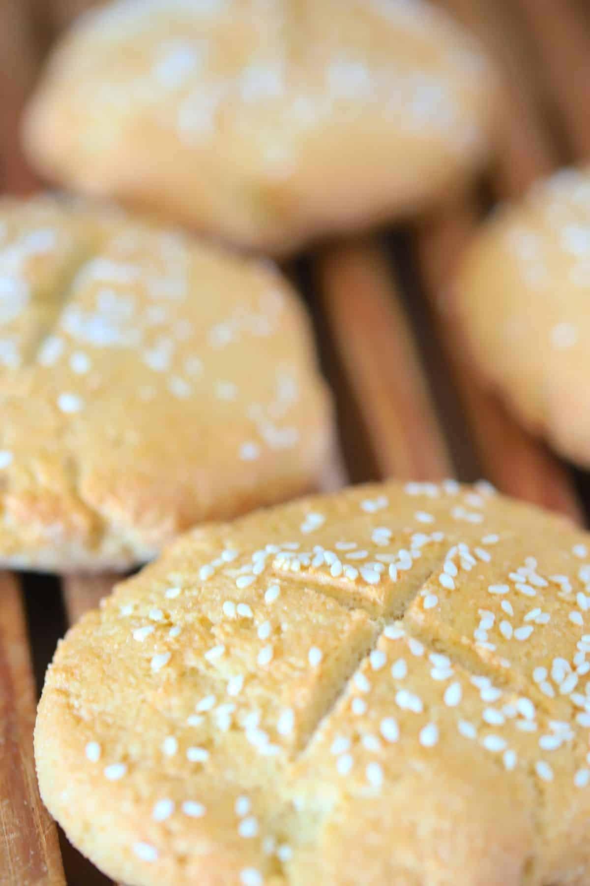 4 hamburger buns on a cutting board