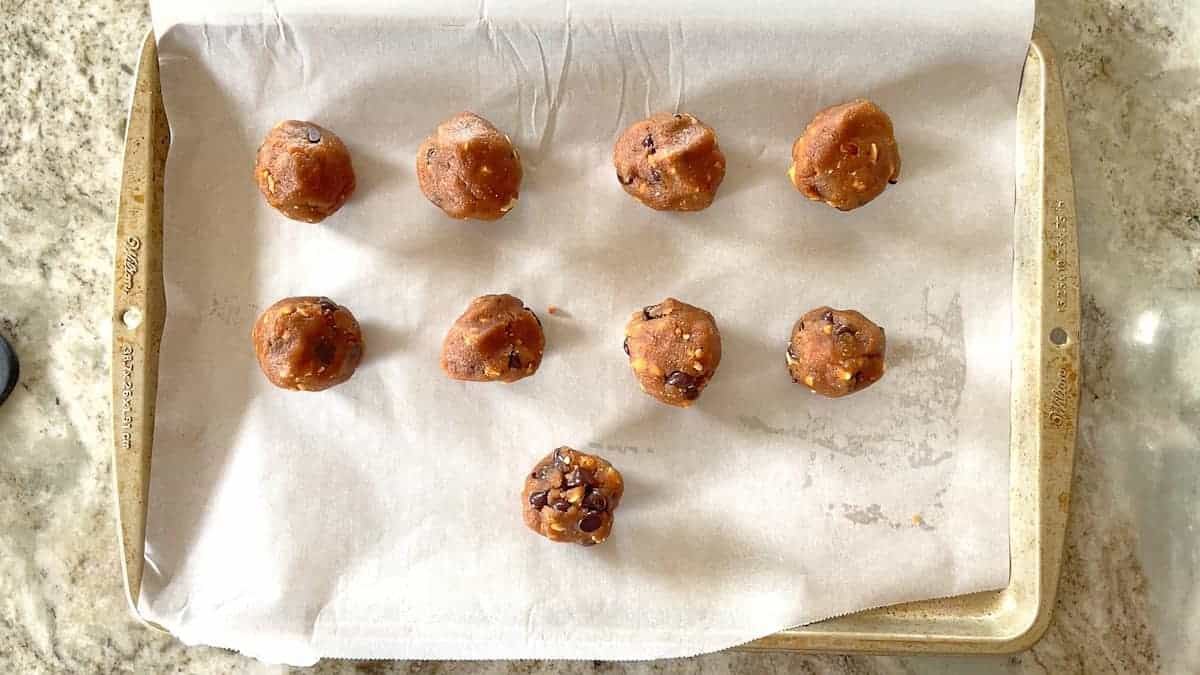 balls of 1 inch cookies on a baking sheet