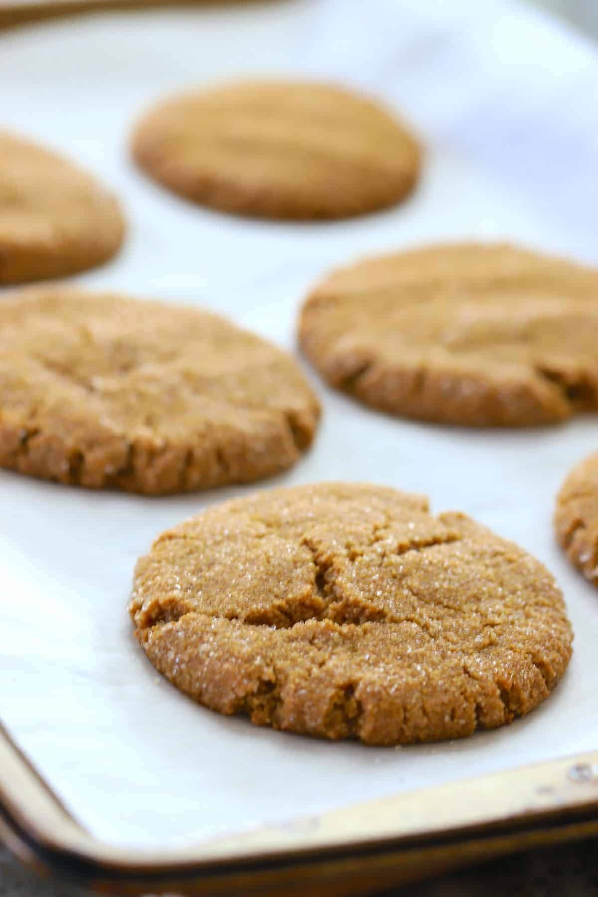 baked cookies on a parchment lined cookie tray