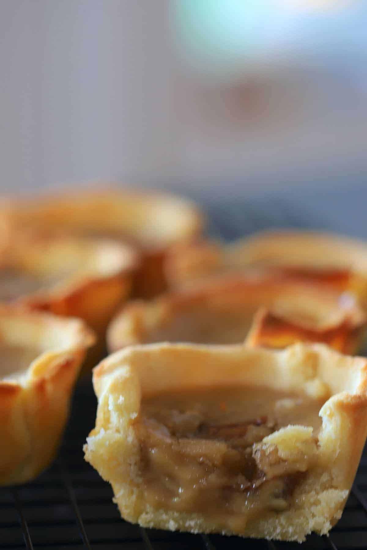 butter tart cut open showing the gooey filling.