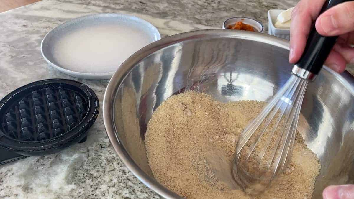 whisking together the dry ingredients in a bowl
